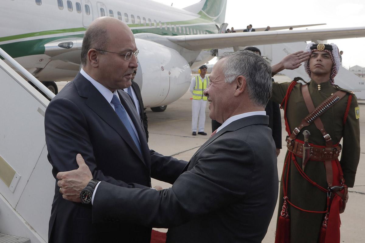 الملك في مقدمة مستقبلي الرئيس العراقي لدى وصوله إلى عمان
