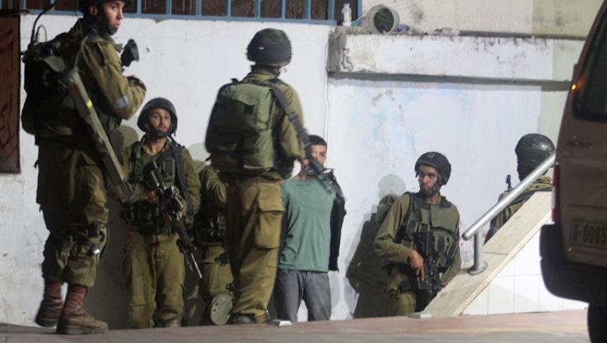 """بالأسماء- اعتقال (15) مواطناً.. وقوات الاحتلال الإسرائيلي تؤمن دخول مئات المستوطنين لقرية """"كفل حارس"""""""