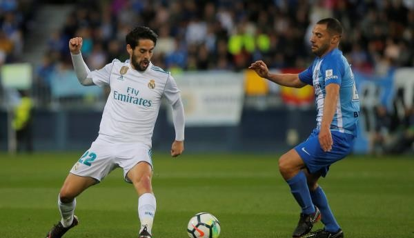 ريال مدريد يقبل هدية برشلونة ويتجاوز مالاجا بثنائية